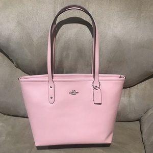 Light pink coach zip tote bag